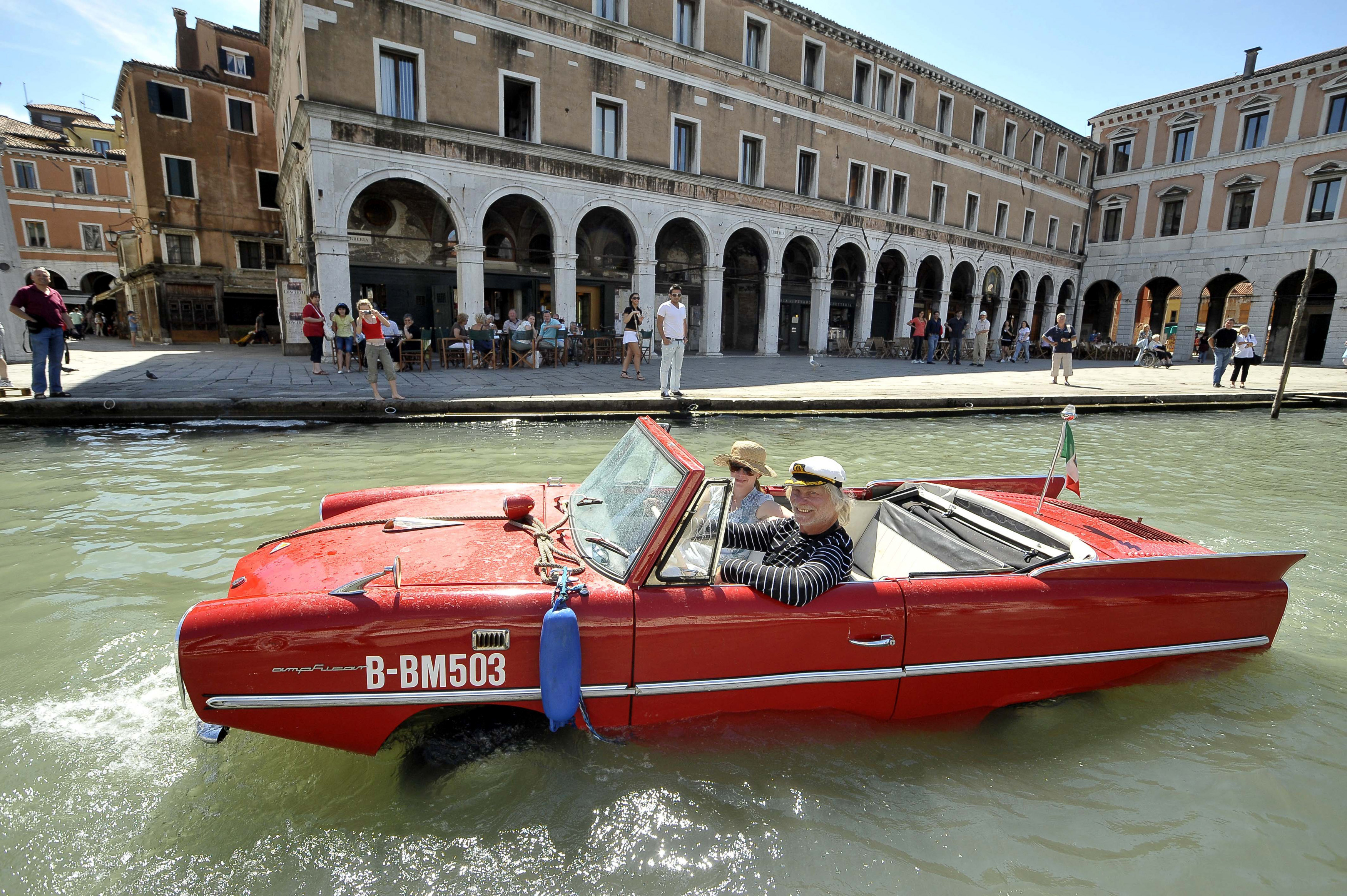 Weise pilots his 1961 Amphicar down the Grand Canal in Venice